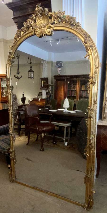 Very large arched mirror with scrolling flowers