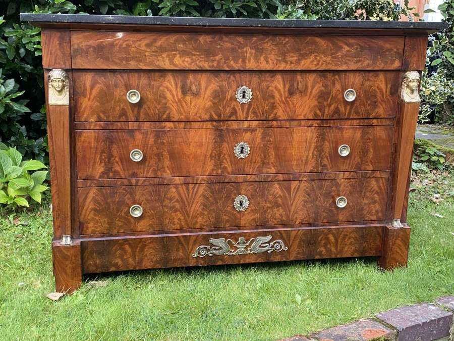 French Empire commode in flame mahogany